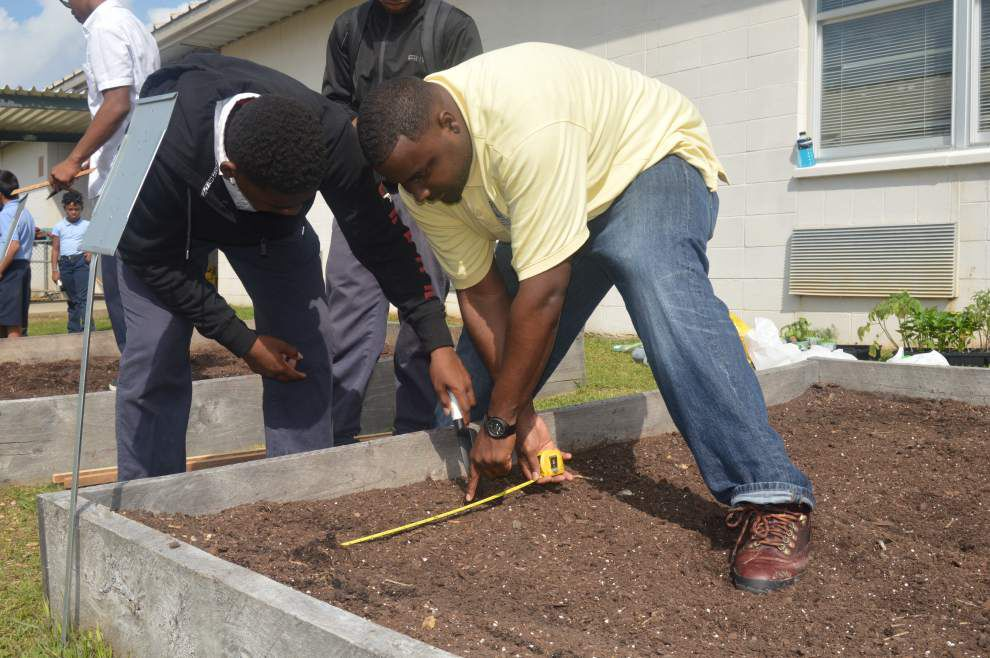 Growing students  Volunteers help St. Helena Arts and Technology Academy develop garden _lowres