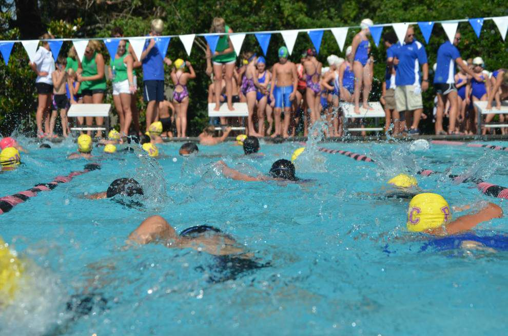 Pelican swim team wins division title _lowres