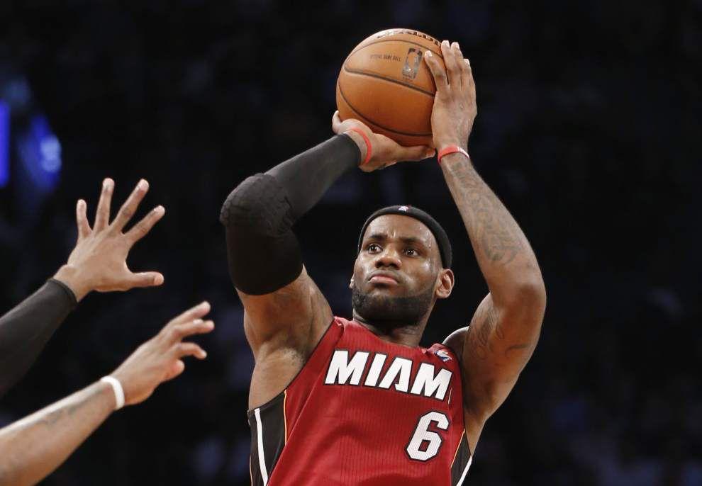 Heat's James scores 49 in 102-96 win _lowres