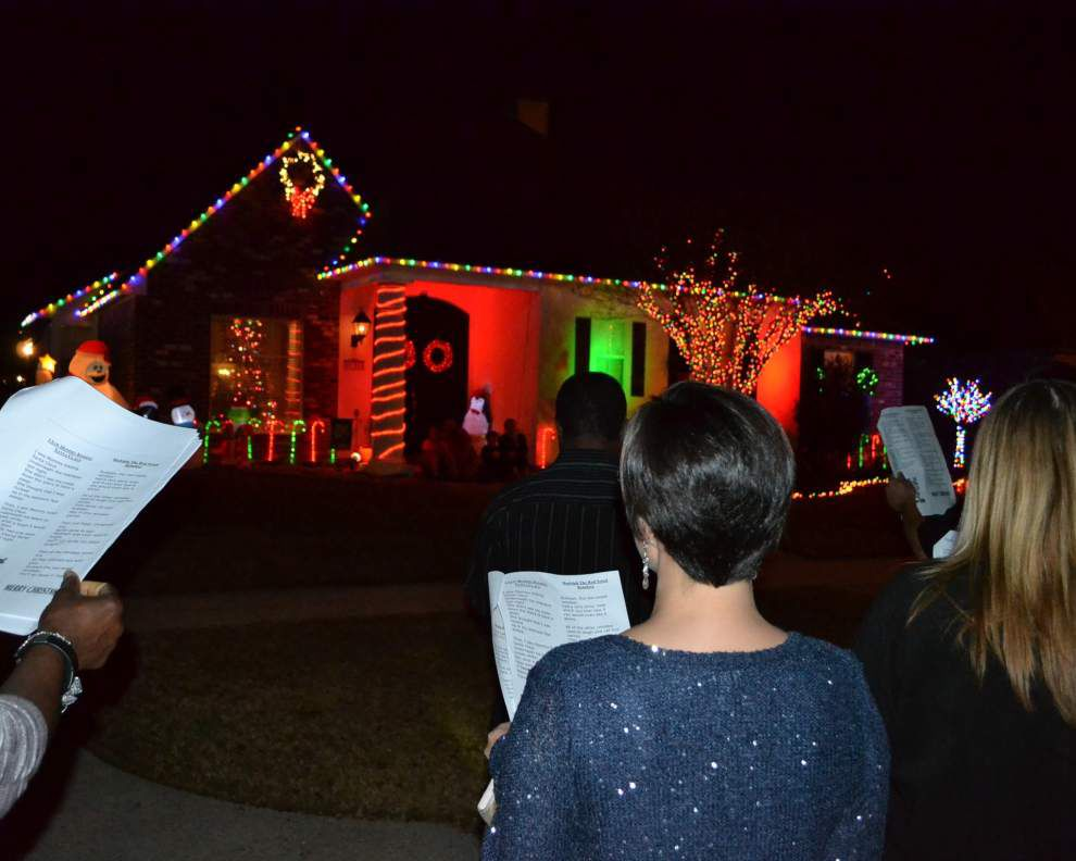 Rotarians go caroling for Christmas cause _lowres