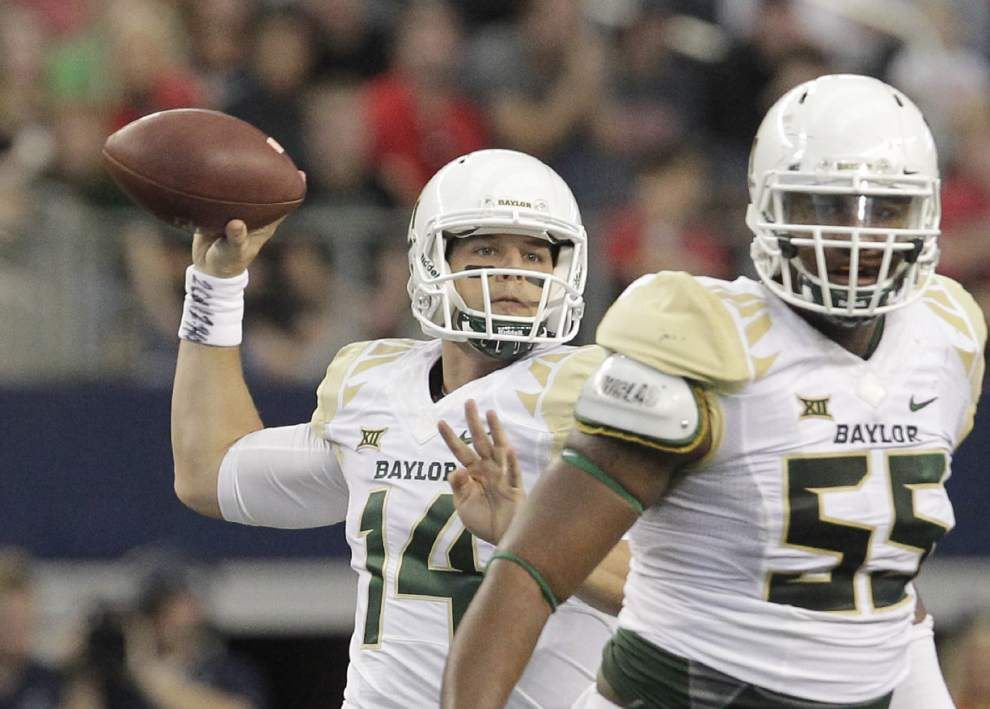 Baylor quarterback Bryce Petty progressing after concussion; Ohio State official praises Michigan quarterback Devin Gardner _lowres