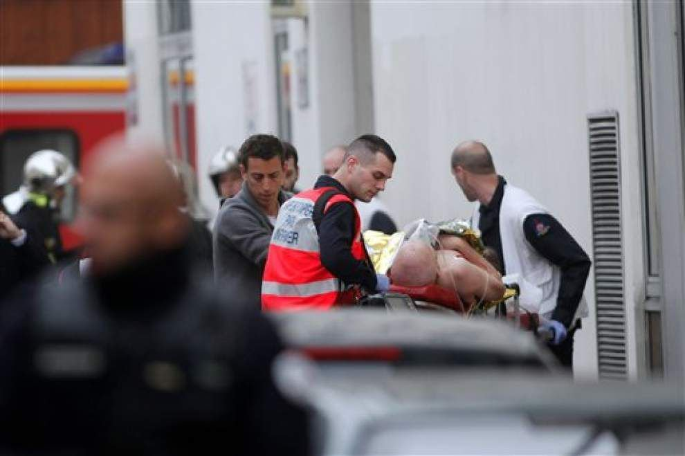 Authorites hunt 2 in Paris shooting that killed 12; 1 surrenders _lowres