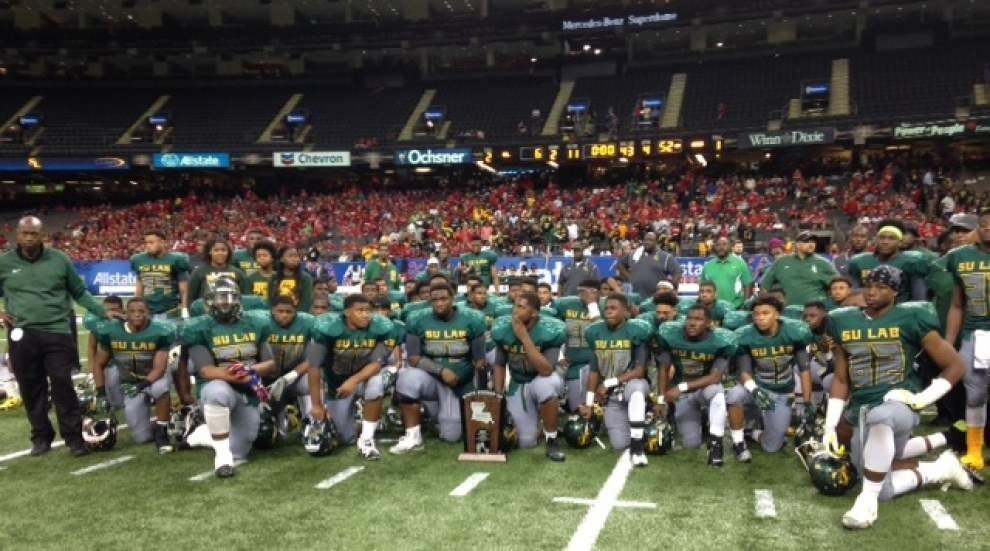 Ouachita Christian defeats Southern Lab 52-6 to win the Division IV select football championship _lowres