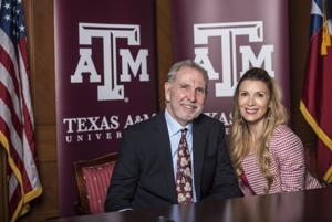<p>President Michael Young and his wife, Marti Young, speak with The Battalion reporters during his first official day at A&M Friday.</p>