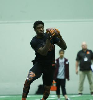 <p>Brandon Williams, who switched from running back to corner, secures the ball during Pro Day.</p>