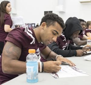 <p>Christian Kirk signs his autograph during Fan Appreciation Day on Saturday, August 22nd. </p>
