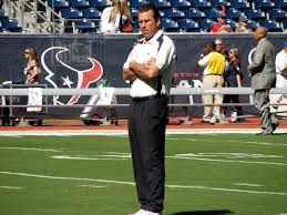 Former Aggie QB and now Denver Broncos head coach Gary Kubiak takes center stage