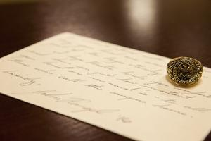 <p>Handwritten letters are one of a muster host's responsibilities towards the honored families.</p>