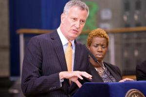 <p>AN AGENCY IN CRISIS: Mayor de Blasio last week describes the financial hole faced by the Housing Authority as his administration released the 'NextGeneration' plan. Part of the strategy to save money and generate revenue includes shedding or transferring 1,000 positions. Looking on is HA Chair Shola Olatoye.</p>