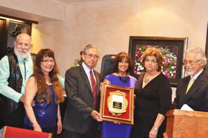 <p>The Griego Family of the Griego Insurance Agency won the 2014 Chenoweth Award at last year's awards banquet, which was sponsored by the Trinidad-Las Animas County Chamber of Commerce. From left to right are Ed, Kathleen  and  Karen Griego and Master of Ceremonies Tom Perry.</p>