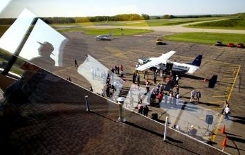 <p>A party was held at the Venango County Airport to welcome and announce their new air carrier, Southern Airways Express, which will be expanding services at the airport. The open house was held to allow people to see the services offered and to even get a view from the observation deck above the terminal (pictured above). (Photo by Richard Sayer)</p>