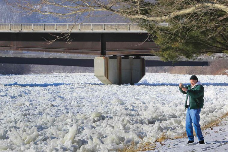 Officials keeping close watch on rising, ice-choked river