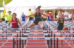 <p>Leah Sheets (center) runs the 100-meter Hurdles at the Colorado State 2-A Track and Field Championships. (Photo by John King)</p>
