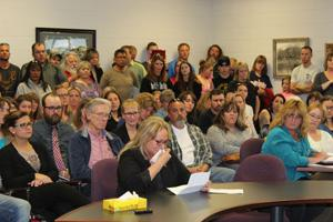 <p>A tearful Lucy Cafiero (front center) explains to the Platte Canyon School District board May 23, how Fitzsimmons Middle School Principal Rim Watson dealt with her son who was being bullied by another student. Caliero said after working with Watson, her son was happy to get up and go to school. Watson was placed on paid administrative leave and at the meeting, the board voted not to renew Watson's contract. (Photo by Walter L. Newton/The Flume)</p>