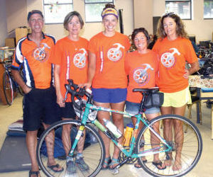 Riders with the eighth annual Fuller Center Bicycling Adventure stop