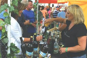 Aspen Peaks Cellars pours a glass of pinot grigio