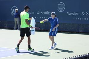 Handing off the tennis balls