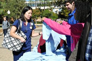 UTA Ambassadors exchange T-shirts for UTA gear at Mav Swap