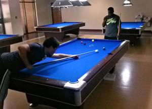 Students playing billiards