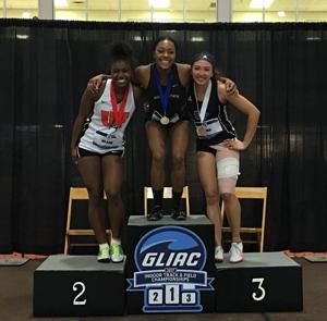 GLIAC 60m hurdles champion Karrington Seals (middle)