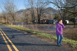 <p>Mercedes Hernandez wipes away tears after surveying her home (in the background) after flood waters ravaged her community. Families were evacuated from a mobile home park in Tuckasegee around 4 a.m. Tuesday (Dec. 29). Flood waters surrounded the homes quickly, forcing many to flee with only the clothes on their back. Jackson County Emergency Management crews are coordinating relief efforts for those involved. Tuesday's flooding is the second in less than a week; the Tuckaseigee River was also out of its banks on Christmas Eve, producing flooding in many of the same spots. More photos are on Page 9A and The Herald's Facebook page, www.fb.com/thesylvaherald.</p>