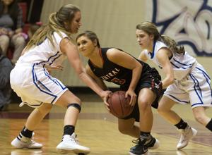 <p>Wilson's Maria Mask and McKinzy McCollum pressure Central's Brianna Poole to turn the ball over during the Class 4A, Area 16, basketball tournament Monday night at Deshler High School.</p>