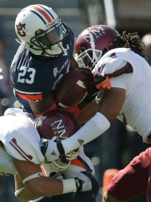 Smiles replace turmoil at Auburn