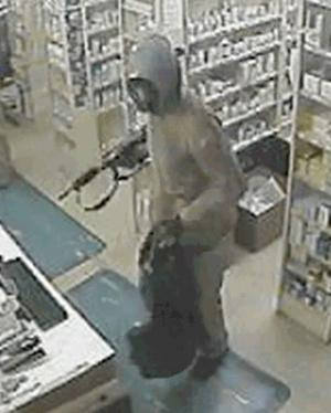 Reward offered in pharmacy robberies