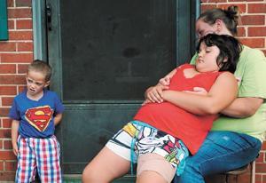 Mauled girl awaits rabies test results