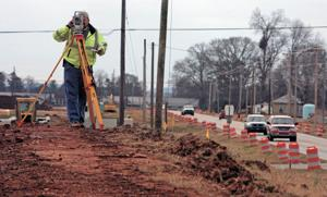 Road work continues on Wilson Dam