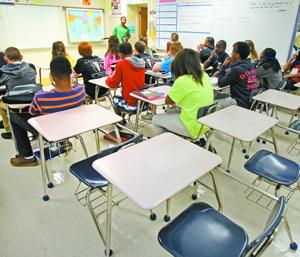 Report links absenteeism to dropouts, troubles
