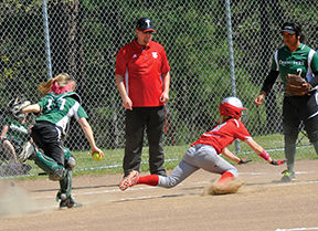 <p>St. Bernard catcher Emily Denny gets ready to tag out Trinity's Tita Tanuvasa on her way back to third base April 22.</p>