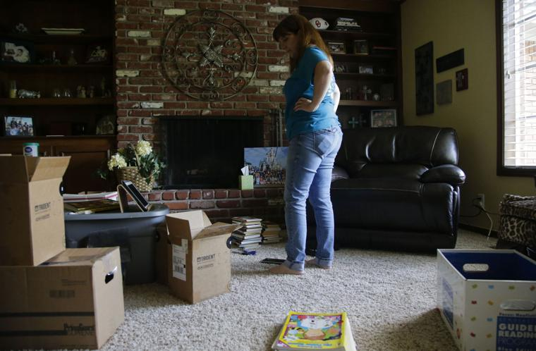LeAnna Snyder Former Teacher At Carnegie Elementary Stares The Boxes Of Kids Books On Her Living Room Floor Aug 5 JESSIE WARDARSKI Tulsa World