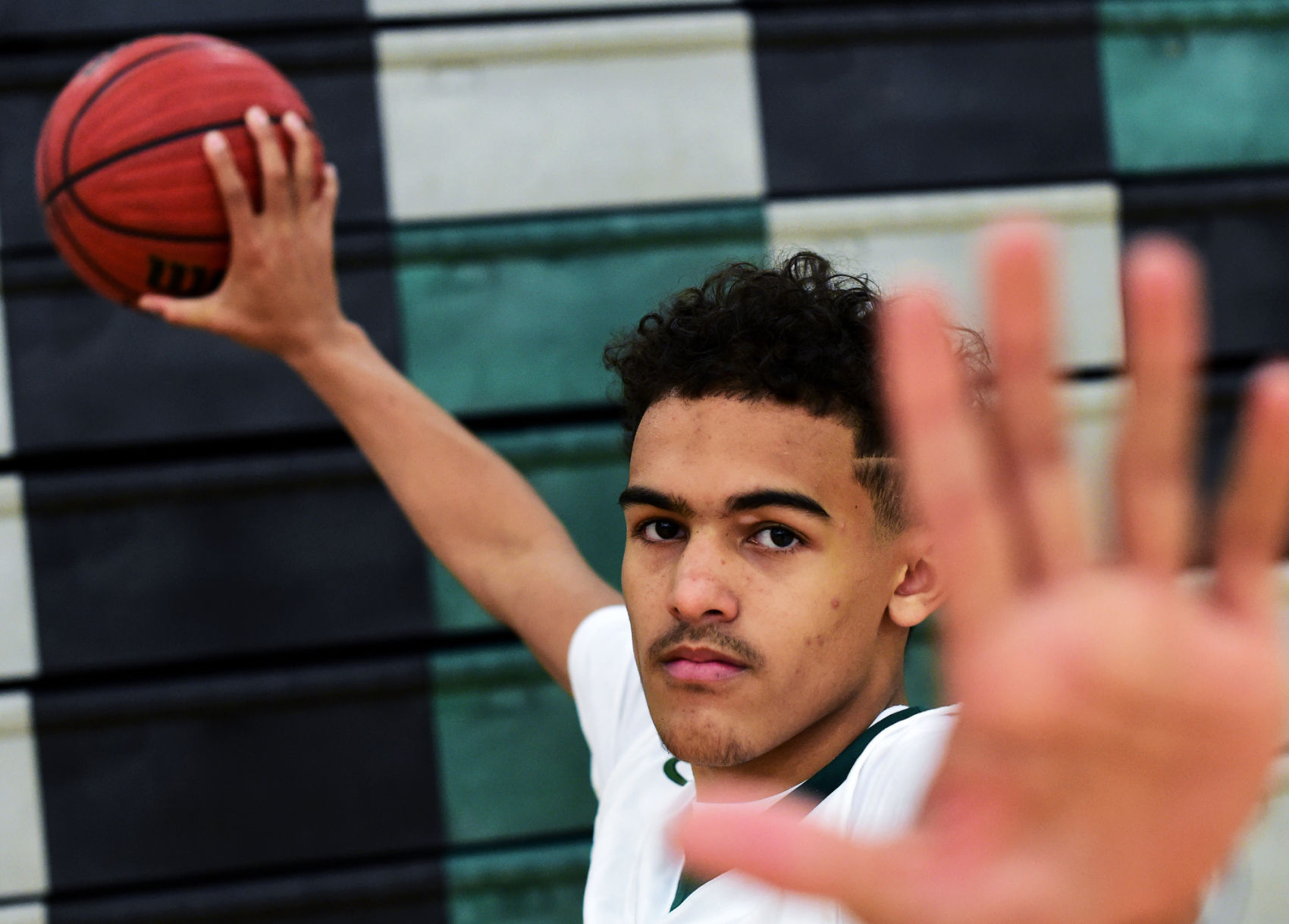 Men's Basketball - Norman North's Trae Young and parents say why OU and OSU made his final three
