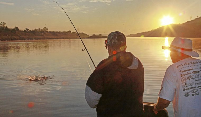 Kelly bostian sunrise below keystone dam tops this week 39 s for Keystone lake fishing report