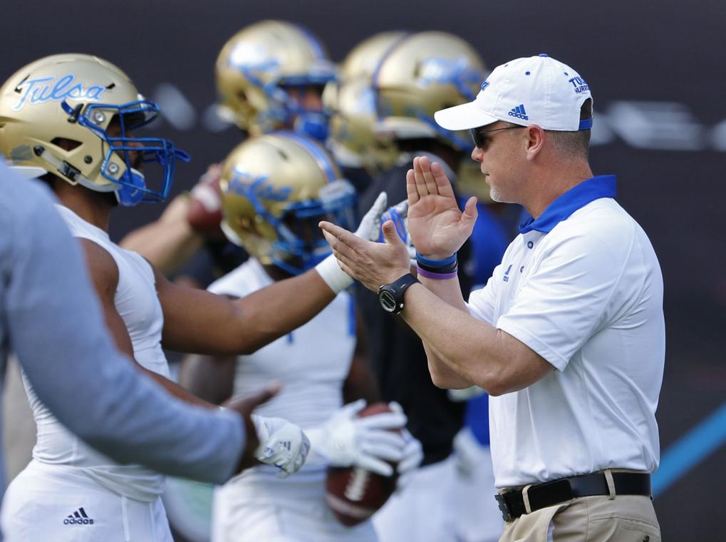 Tulsa head coach Philip Montgomery greets players during ...