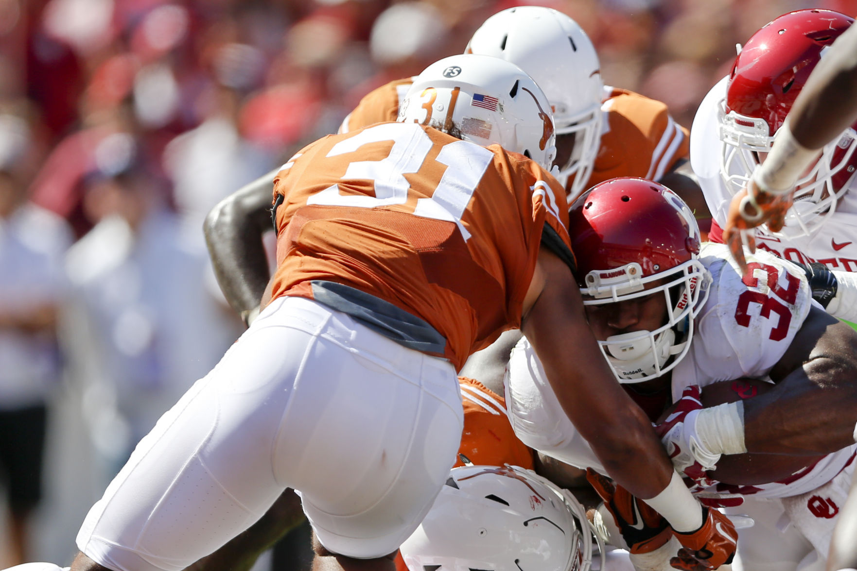 Texas coach Strong enters Oklahoma game under pressure again
