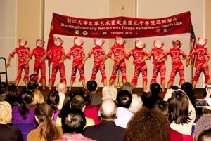 The back of the costumes worn by performers. A very diverse group of people were present at the event.