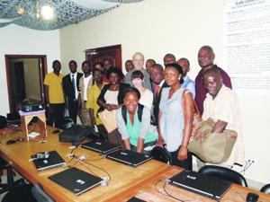 Keating (top row, center), Conklin (second row, center), Appleton (fourth from the left, wearing yellow), and the rest of the group at iLab Liberia, in a photo taken this summer.