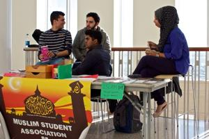 Members of the Muslim Student Association Preparing to Speak to Students in the Campus Center Terrace