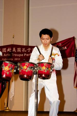 A performer working hard to provide the audience with a thunderous beat.