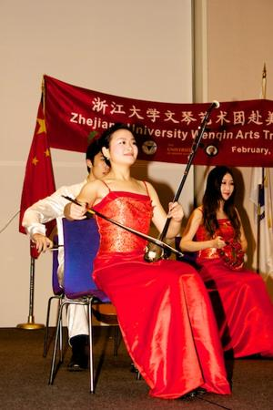 A student from Zhejiang University playing a traditional Chinese instrument.