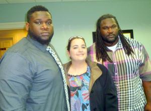 Left to right: Roychester Harris, owner; Jennifer Joyce Tompkins, his attorney; and McKenzie Harris, employee, brother and bouncer.