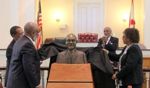 Judge Huffman's bust being unveiled by his family.