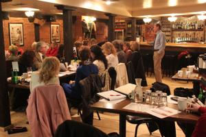 <p>Alexandria City Planner Mike Weber asks for feedback from a large group of Alexandria Downtown Merchants Association members at their monthly meeting. The group currently meets once a month on the fourth Friday of each month in the downstairs of Raapers.</p>