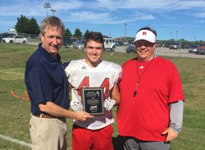 <p>Pictured from left are Garth Bouldin of Gateway Tire and Service Center, Connor Jeffries and Ravenwood head coach Will Hester.</p>