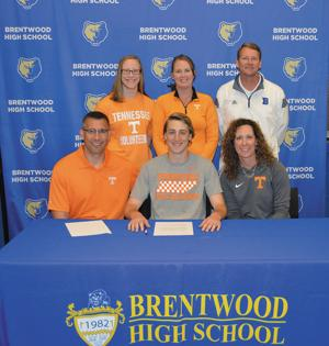 <p>Tim Raab of Brentwood will be joining the University of Tennessee Swimming Team in the fall. The Bruin senior signed his paperwork with (front row) his father and mother, Greg and Jamie, at his side, along with (back row) sister Allison Raab, coach Brenda Vroon and Brentwood athletic director Ronnie Seigenthaler watching.</p>