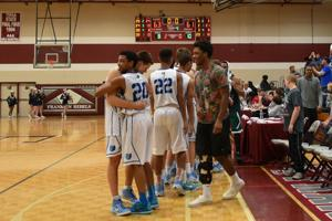 <p>Seniors Grant Teichmann and Jalen Lawson (20) guaranteed at least two more games in the their high school basketball careers after leading the Bruins to a 63-61 Region 6-AAA semifinal win over Independence at Franklin High School, Thursday, Feb. 26, 2015.</p>