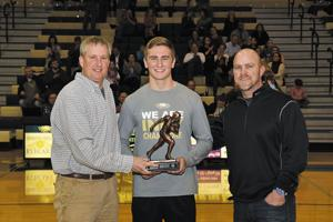 <p>Garth Bouldin of Gateway Tire, left, presents the trophy for player of the year to Andrew Bunch of Independence.</p>