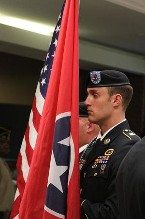 <p>The Color Guard from the 1-327th Infantry, 101 Airborne Division (AASLT) based in Fort Campbell, Ky prepares to retire the colors nearing the completion of the Williamson County Memorial Day 2015 observance and ceremony.</p>